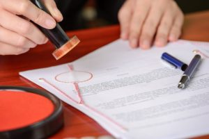 Notary sealing a document, Integrity Surety